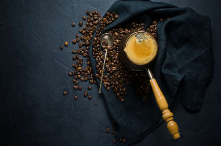 Coffee in Turk, coffee beans. Black background, top view, space for text Imagens