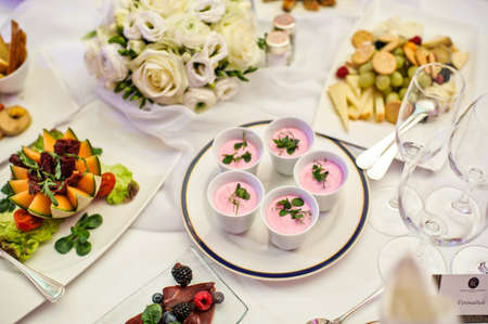 Pink Panna cotta in cups. Banquet table in the restaurant