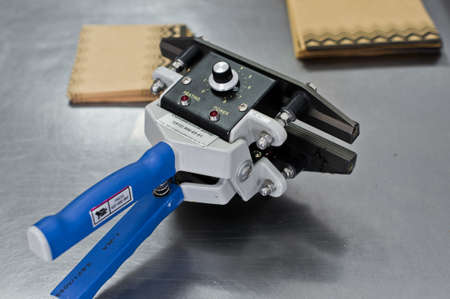 Industrial heat sealer Stock Photo