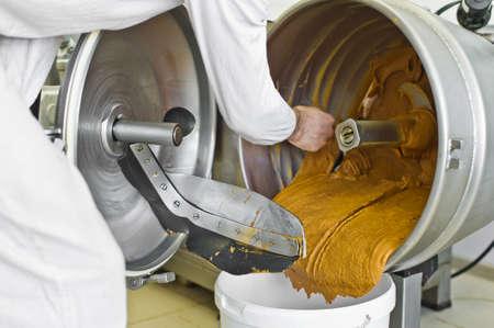 Peanut butter production, industrial mixer, food industry, conveyor line