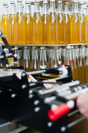 Moving Bottles on Labelling machine for Industry, food industry, conveyor line