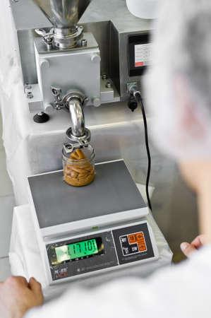 30.03.2019 Russia, St. Petersburg - worker uses industrial dispenser, food industry, conveyor line