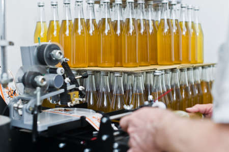 30.03.2019 Russia, St. Petersburg - Moving Bottles on Labelling machine for Industry, food industry, conveyor line