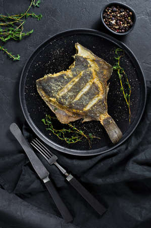 Grilled flounder, balanced healthy food. Gray background, top view, space for text 免版税图像