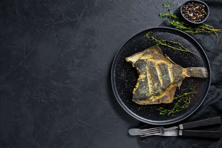 Grilled flounder. Gray background, top view, space for text