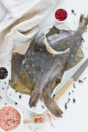 Raw flounder, ingredients for cooking. White background, top view, Banque d'images