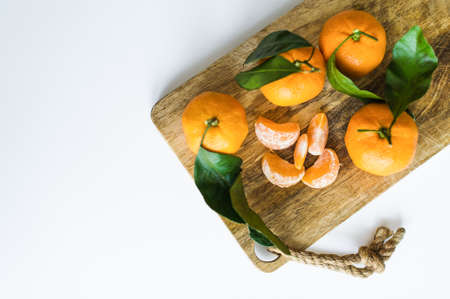 Tangerines with branches on a white background