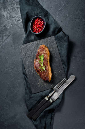 Steak of marbled beef black Angus roast rear. Black background, top view Banque d'images
