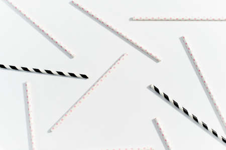 The concept of multi-colored straws for drinking on white background Stock Photo