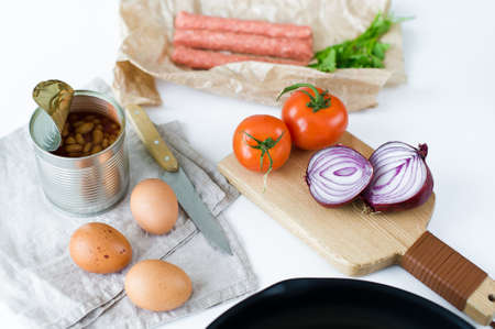 The concept of cooking an English Breakfast on a white background