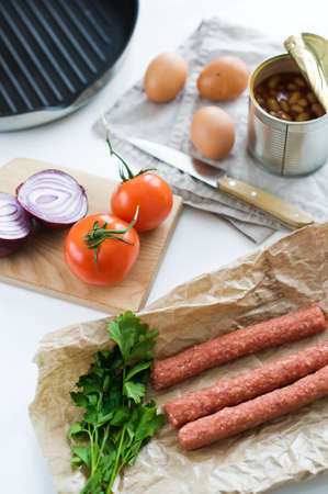 Ingredients for cooking an English Breakfast on a white background