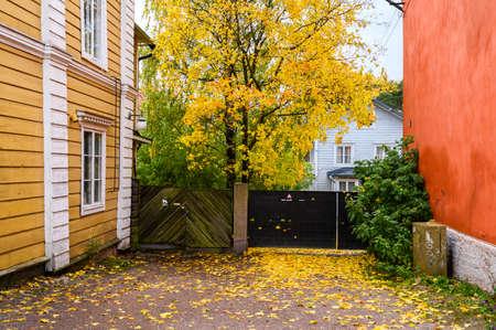 Porvoo, Finland. Yard full of yellow autumn leaves. Stockfoto