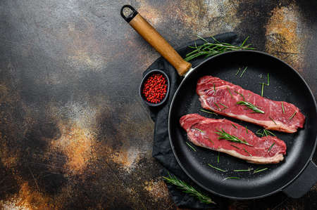 Fresh meat, marbled beef, raw sirloin steak. Dark background. Space for text. Flat lay