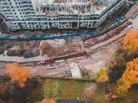 Aerial view on the construction site, the work of the excavator and builders. Autumn, St. Petersburg, Russia Stockfoto