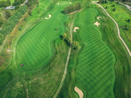 Aerial photos of Golf club, green lawns, forests, lawn mowers.