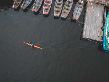 Aerialphoto rower training on the river in a kayak