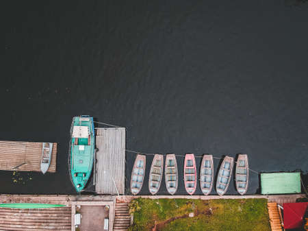Aerialphoto boat station with pier, bill boats, kayaks and rowing
