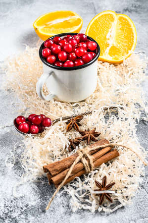 Mulled Wine recipe. Ingredients with cranberries, oranges, cinnamon, anise and cardamom. Gray background. Top view.