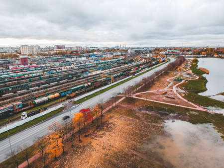 Cargo trains. Aerial view of colorful freight trains on the railway station. Wagons with goods on railroad. Heavy industry. Industrial conceptual scene with trains. View from flying drone. Russia, St. Petersburg
