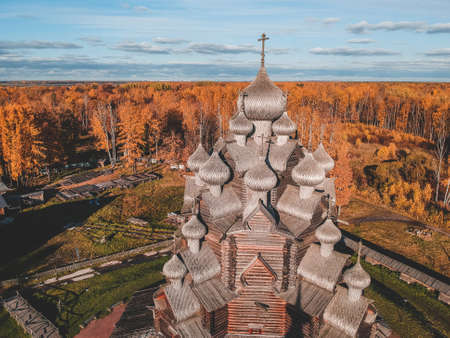 Aerial view of the Old wooden Church Manor Theologian in the autumn forest. Russia, St. Petersburg Banco de Imagens