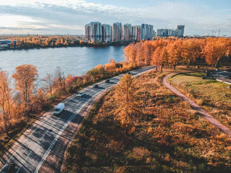 Aerial view of the autumn forest along the Neva river. Russia, St. Petersburg