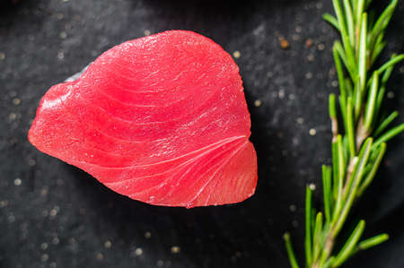 Raw fillet steak tuna. Black background. Top view. Close up.