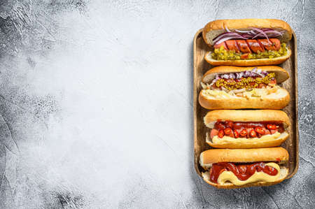 Hot dogs with assorted toppings. Delicious hot-dogs with pork and beef sausages.