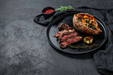 Premium marble beef black Angus. Fried fillet. Organic farm meat. Black background. Space for text. Stock Photo