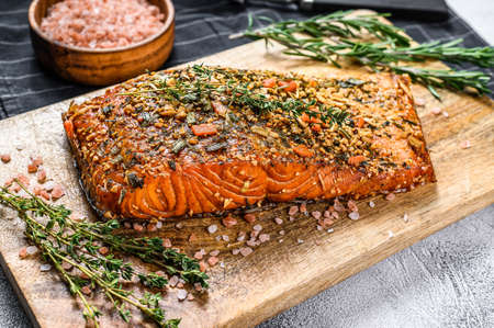 Hot smoked salmon fillet on a cutting Board. trout. Gray background, top view