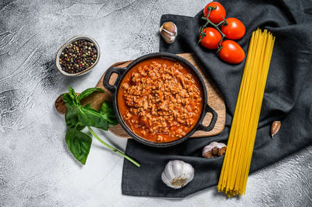 The concept of cooking Pasta bolognese spaghetti with tomatoes, cheese and basil. Gray background. Top view. Stock Photo