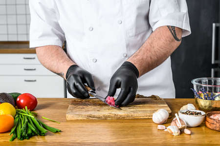 Japanese sashimi chef knife, slice the raw tuna fish for cooking Tartar.