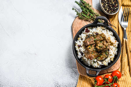Madras beef with basmati rice, Indian food. White background. Top view. Copy space. Stock Photo