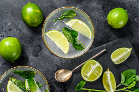 Mojito cocktail, Refreshing mint with rum and lime, cold drink or beverage. Black background. Top view. 写真素材
