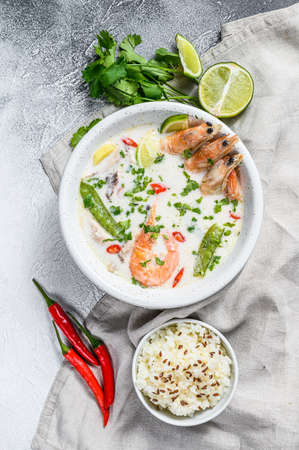 Tom Kha Gai. Spicy creamy coconut soup with chicken and shrimp. Thai food. gray background. Top view