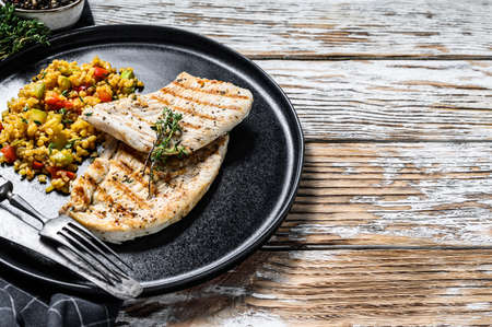 Grilled Turkey breast Steaks with quinoa salad. White background. Top view. Copy space. 版權商用圖片