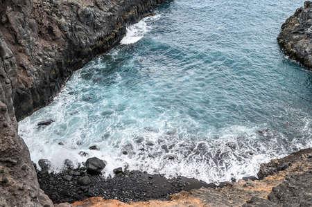 Landscape of the volcanic coast, Atlantic ocean. Selective focus. Los Gigantes, Tenerife. Banque d'images - 150889633