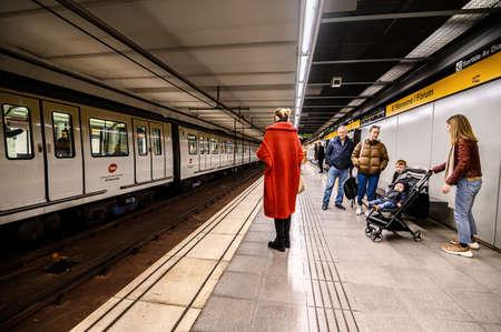 Interior of underground metro station. People on the platform. 03.01.2020 Barcelona, Spain.