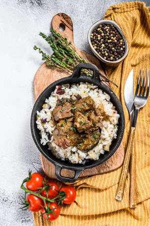 Rice with Stewed Lamb meat. White background. Top view. Stock Photo