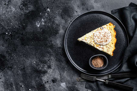 Cottage cheese casserole with chocolate on a plate. Black background. Top view. Copy space. Reklamní fotografie
