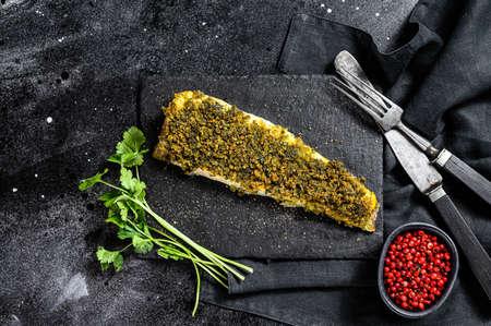 Baked cod fillet. Organic fish. Black background. Top view. Reklamní fotografie