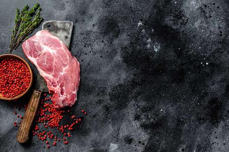 Fresh pork meat, marble steak. Black background. Top view. Copy space. Reklamní fotografie