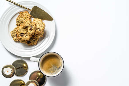 Sweet homemade Oats cookies on a white table. White background. Top view. Copy space.