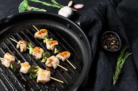 Kebabs - grilled meat skewers, shish kebab with vegetables. Black background. Top view. Stock Photo