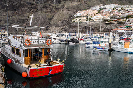 Fishing yacht with spinning wheels in the port. Selective focus. 20.01.2020 Los Gigantes, Tenerife