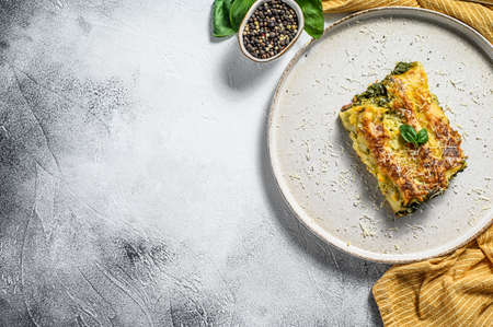 Cannelloni with ricotta and spinach. Italian cuisine. Gray background. top view. Copy space