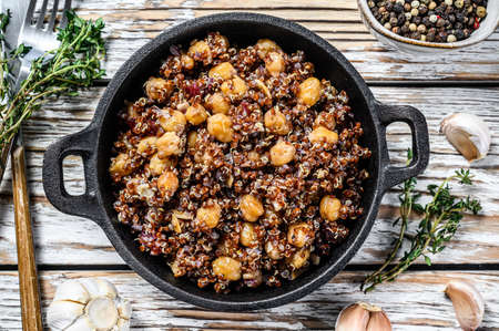Red quinoa salad with chickpeas and thyme. Super food. White background. Top view.