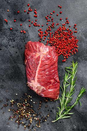 Flat iron steak, raw meat, marbled beef . Black background. Top view Reklamní fotografie