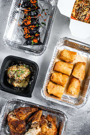 Healthy food and diet concept, restaurant dish delivery. Take away. Asian cuisine, dumplings, spring rolls, dim sum, Peking duck. White background. Top view Reklamní fotografie