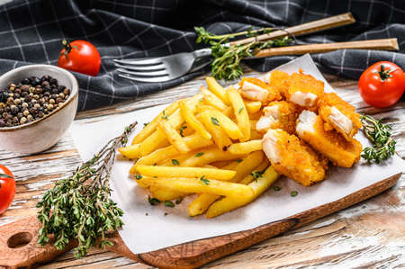 Fish and Chips, british fast food with Tartar sauce. White background. Top view. Reklamní fotografie