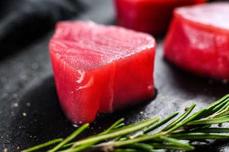 Raw fillet steak tuna. Black background. Top view. Close up.